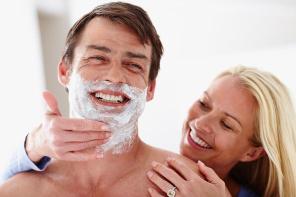 woman-shaving-husbands-face